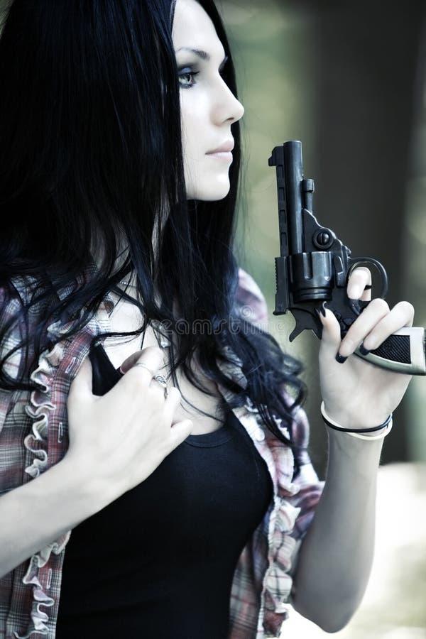 Femme avec la verticale de canon photos stock