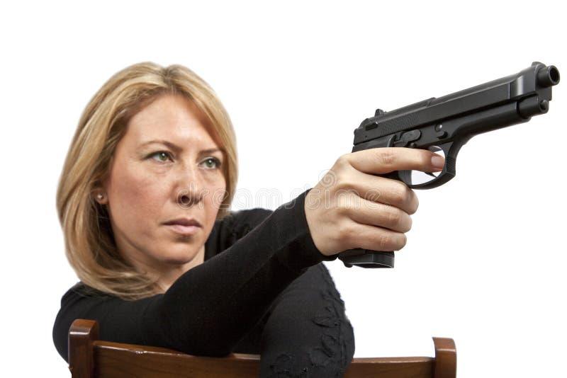 Femme avec le canon photo stock