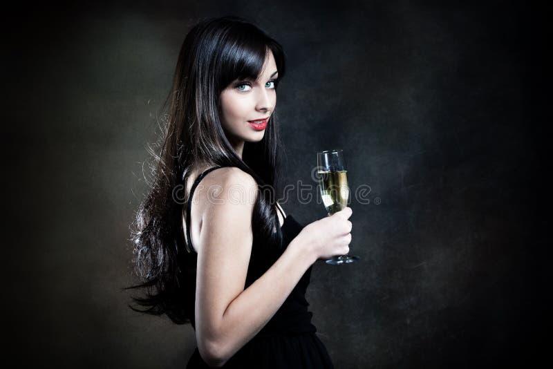 Femme avec le champagne photo stock