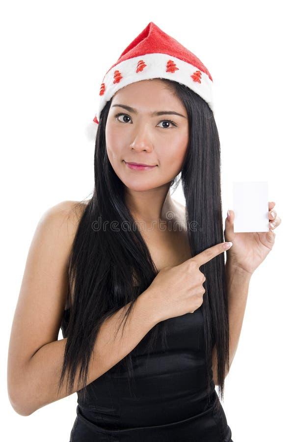 Femme avec le chapeau du père noël et la carte de visite professionnelle de visite image libre de droits