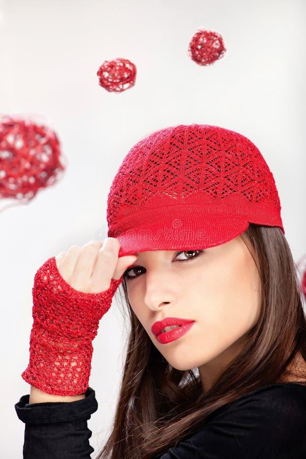 Femme avec le chapeau rouge photographie stock libre de droits