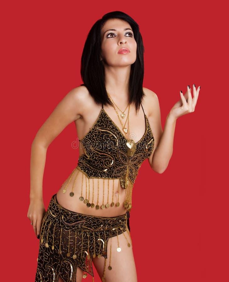 Femme avec le cheveu foncé dans le costume de déesse photo libre de droits