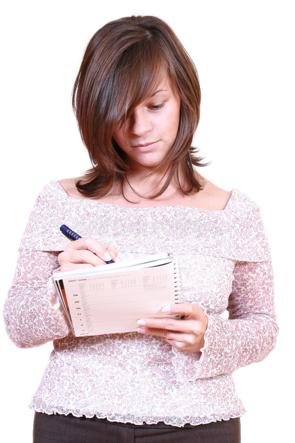 Femme avec le crayon lecteur et le calendrier photographie stock