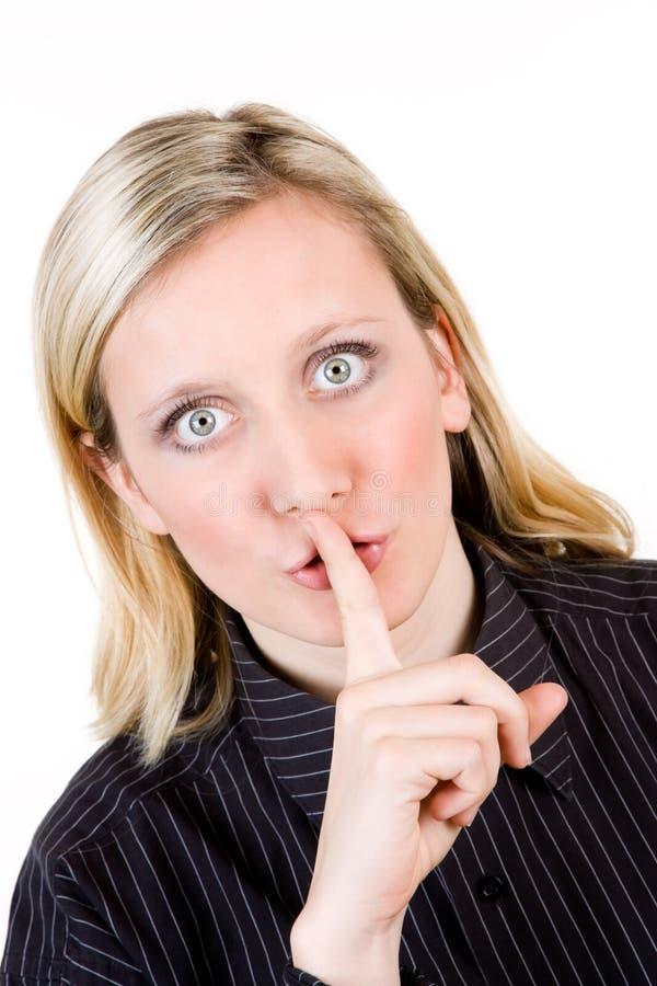 Femme avec le doigt aux languettes image libre de droits