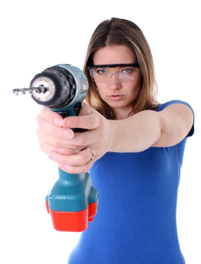 Femme avec le foret de pouvoir images libres de droits