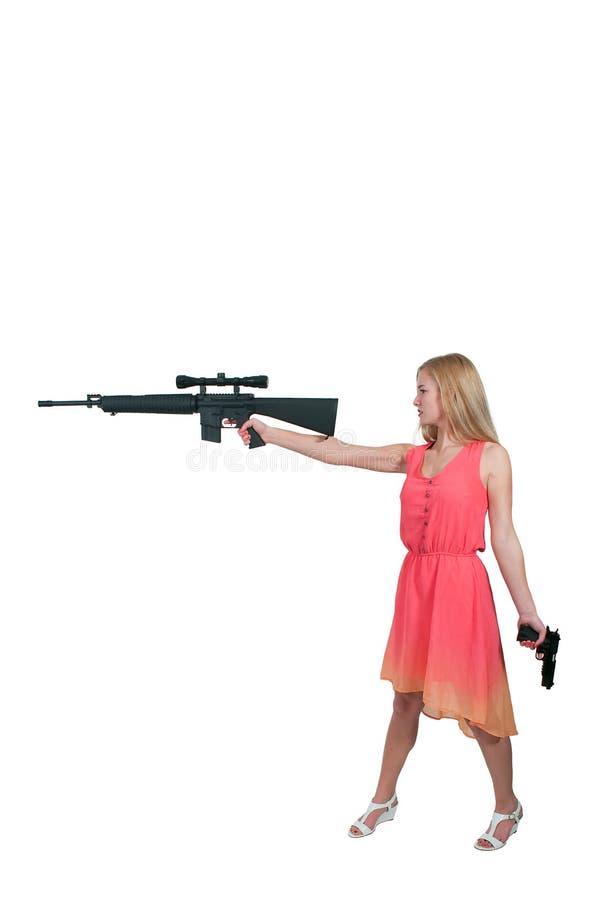 Femme avec le fusil d'assaut et le pistolet image stock