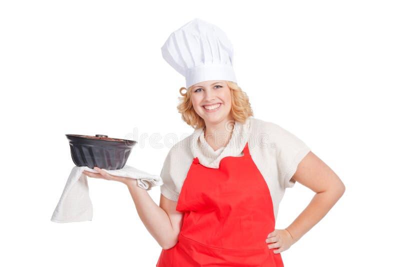Femme avec le gâteau de bundt photos stock
