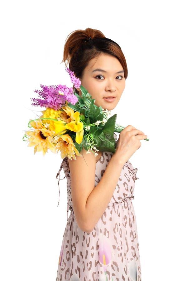 Femme avec le groupe de fleurs photos libres de droits