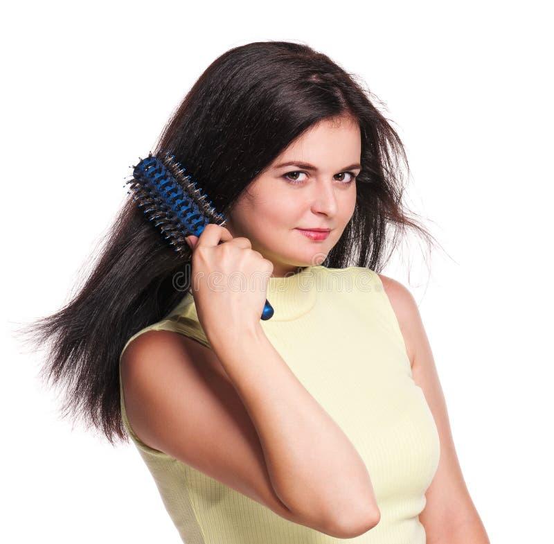 Femme avec le hairbrush images stock