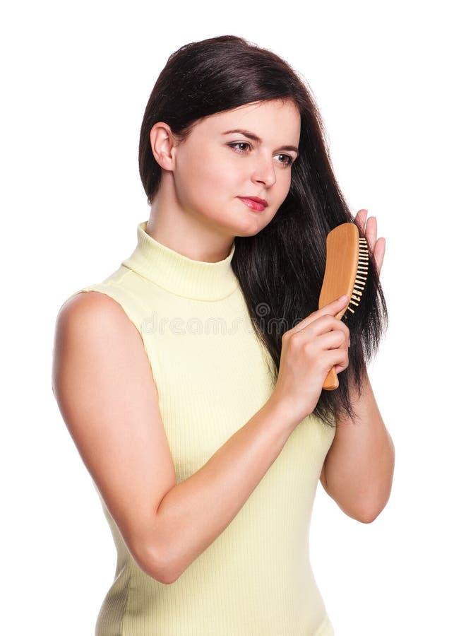 Femme avec le hairbrush photographie stock