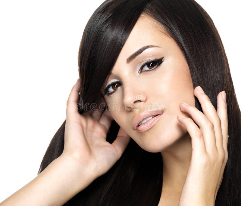 Femme avec le long cheveu droit de beauté photos stock