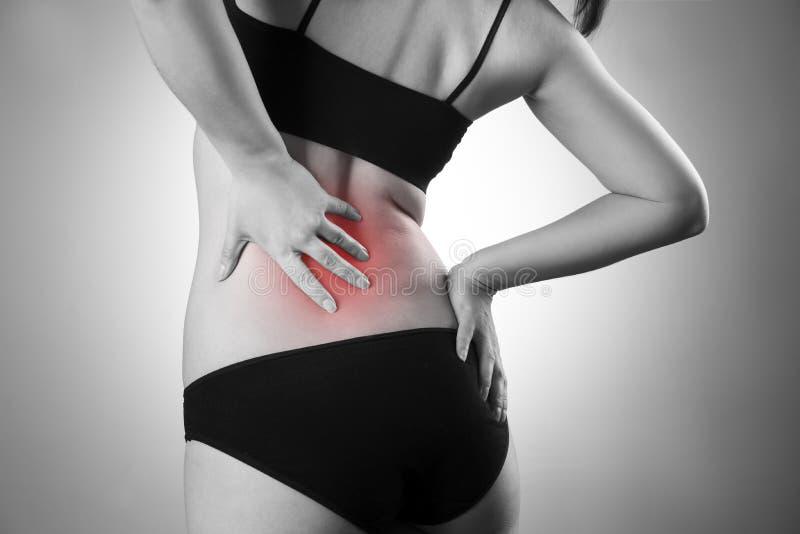 Femme avec le mal de dos Douleur au corps humain image libre de droits