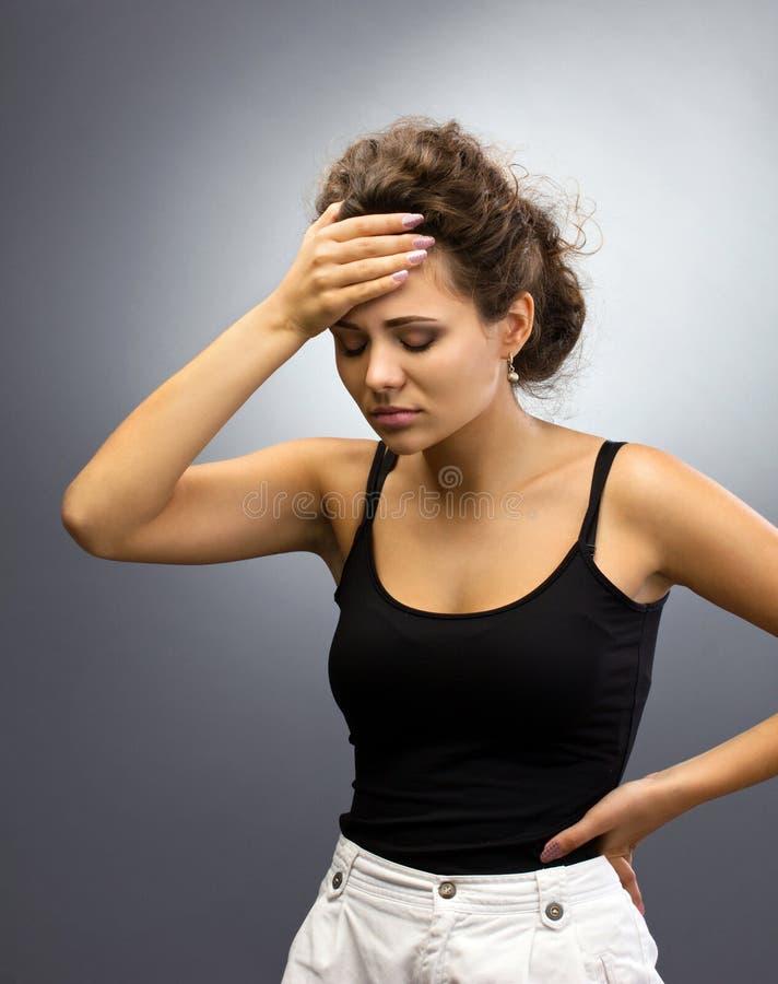 Femme avec le mal de tête photo libre de droits