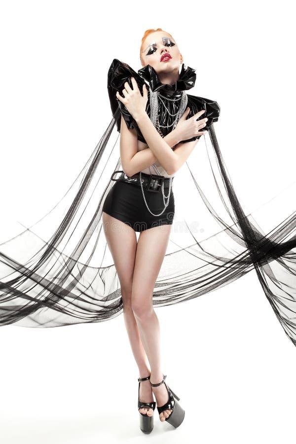 Femme avec le maquillage de mode et vêtements d'isolement sur le blanc photographie stock libre de droits