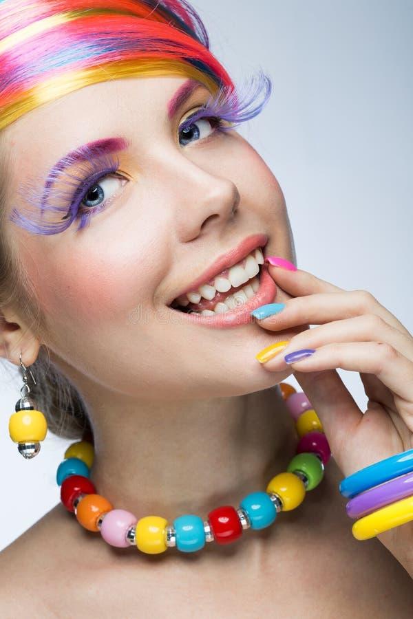 Femme avec le maquillage lumineux photos libres de droits