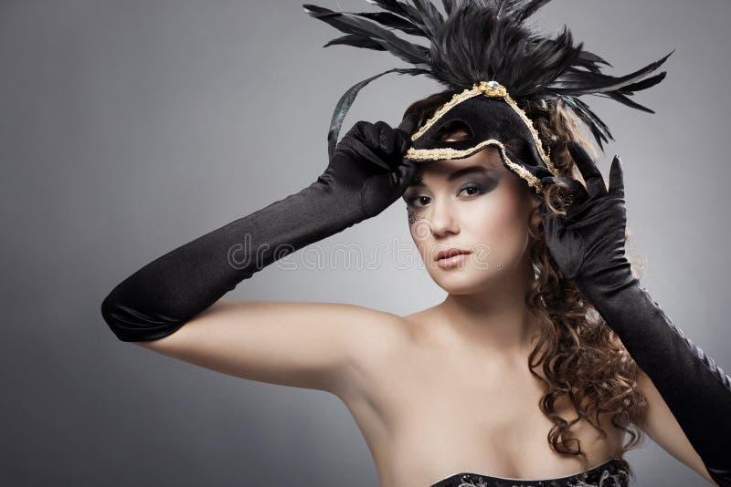 Femme avec le masque de mascarade image libre de droits