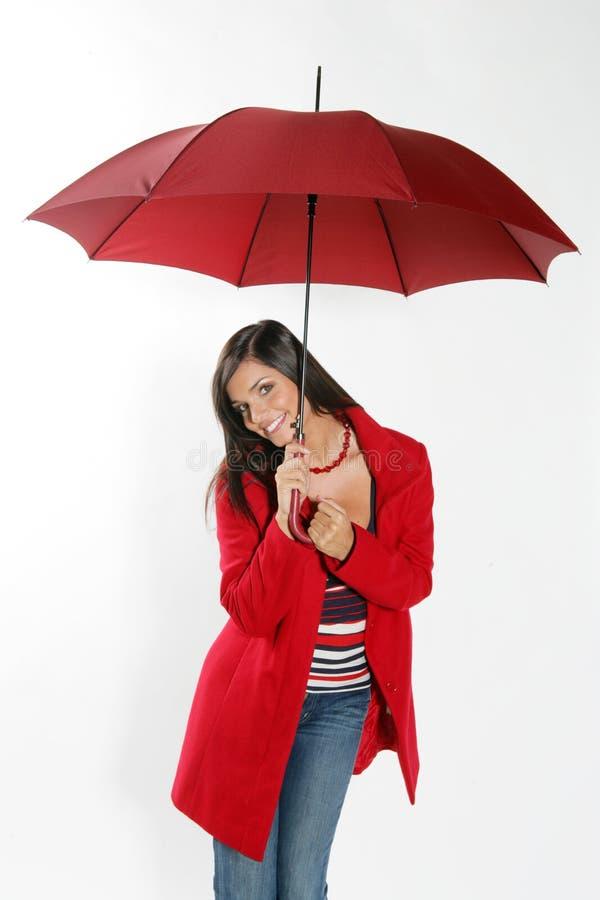 Femme avec le parapluie rouge. photo libre de droits