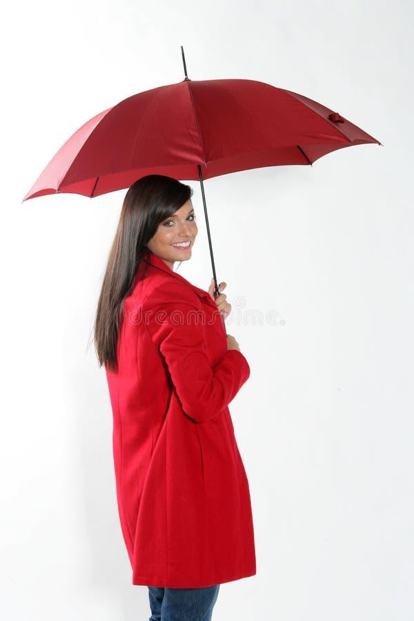 Femme avec le parapluie rouge. photos libres de droits