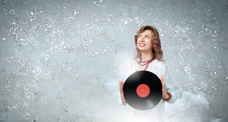 Femme avec le plat de disco photographie stock