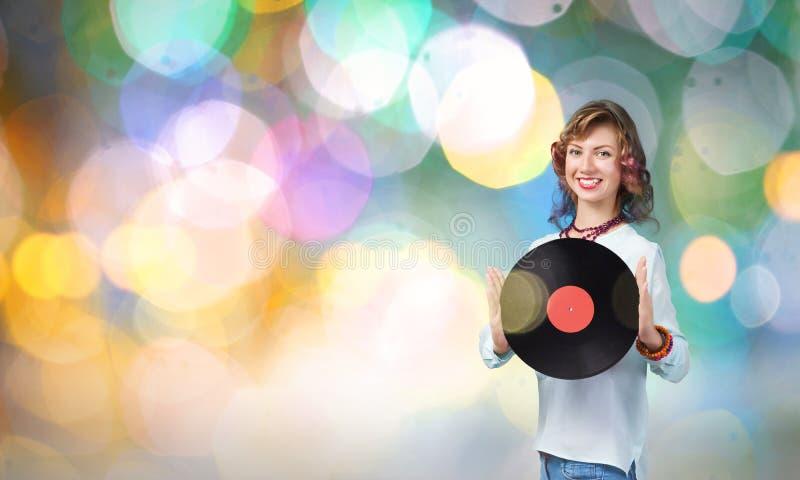 Femme avec le plat de disco photo libre de droits