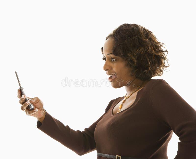 Femme avec le portable. image stock