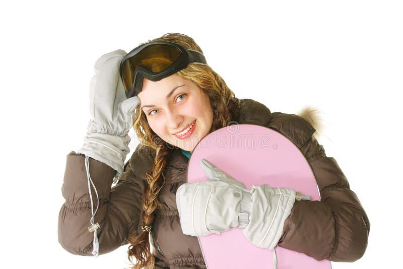 Femme avec le snowboard rose photo stock