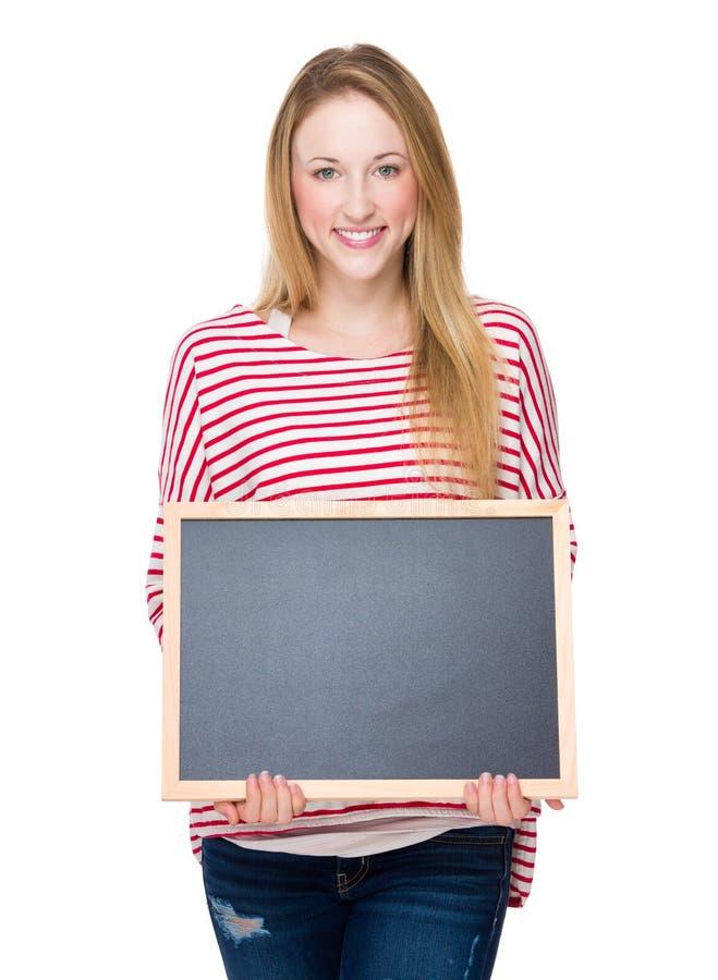 Femme avec le tableau images stock