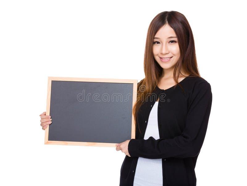 Femme avec le tableau photos stock