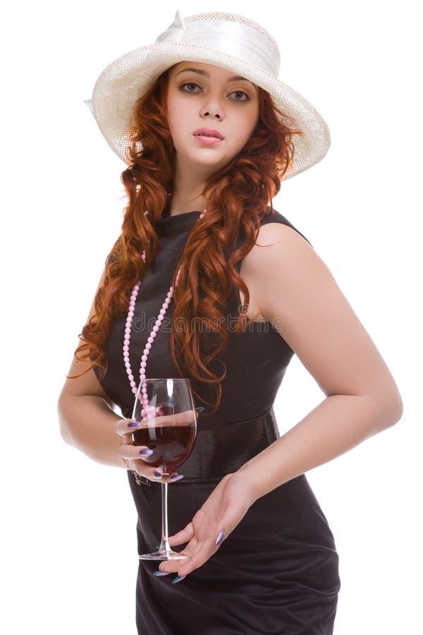 Femme avec le verre à vin à disposition photographie stock
