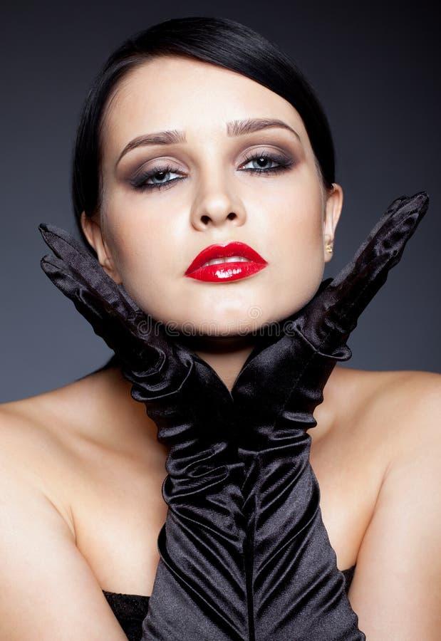 Femme avec les gants noirs photographie stock libre de droits