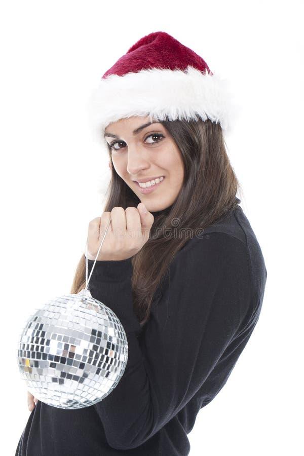Femme avec un chapeau de Noël avec une bille de shinny images libres de droits