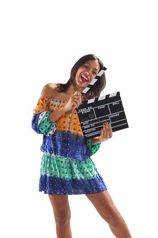 Femme avec un clapet de film image stock