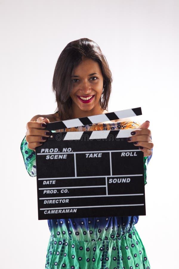 Femme avec un clapet de film photo libre de droits