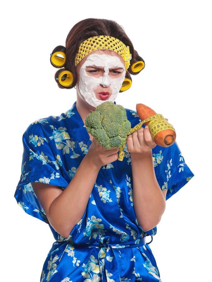 Femme avec un masque images stock