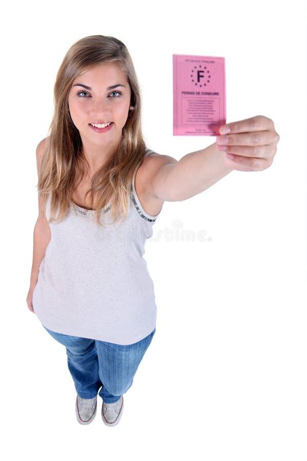 Femme avec un permis de conduire photo libre de droits
