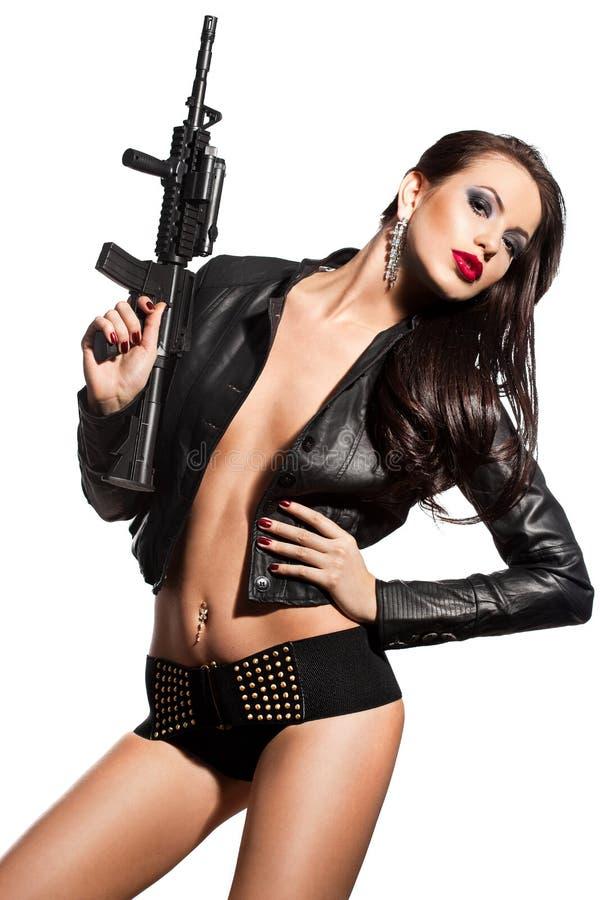 Femme avec un revolver en mains photos libres de droits