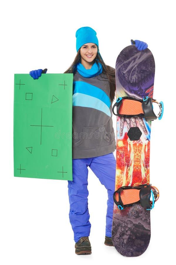 Femme avec un snowboard photographie stock libre de droits
