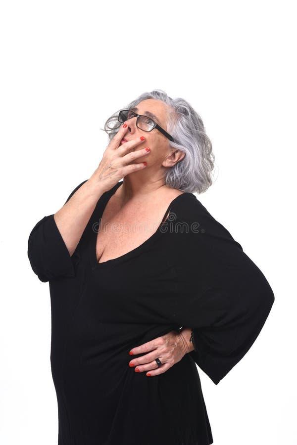 Femme ayant un doute ou une question sur le fond blanc photo stock