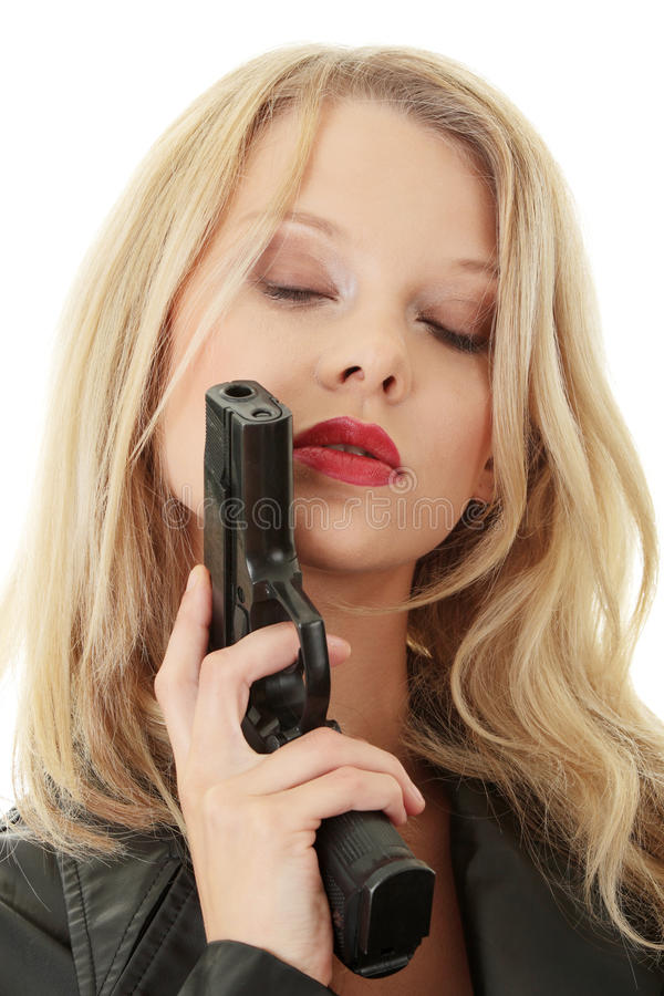 Femme blond sexy avec le pistolet photo stock
