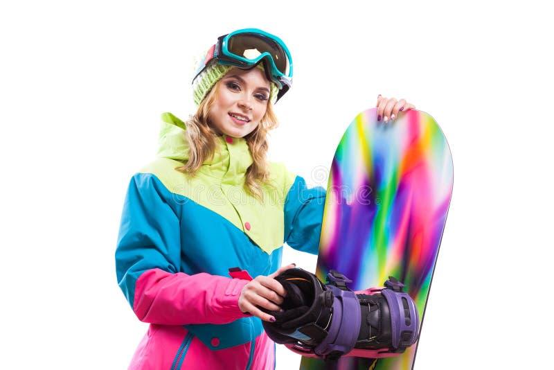 Femme blonde avec le surf des neiges d'isolement photographie stock