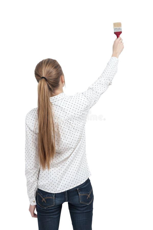 Femme blonde avec un pinceau d'isolement photo stock