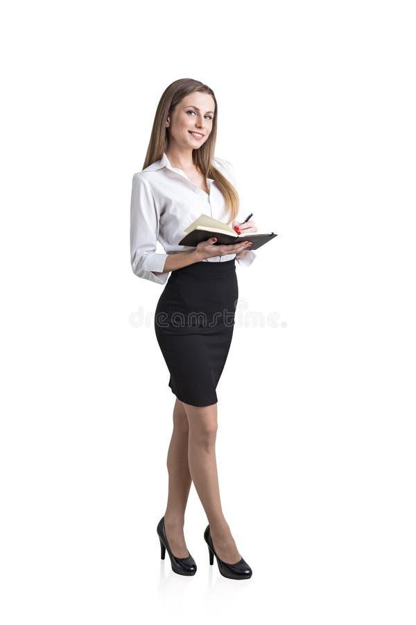 Femme blonde avec un planificateur, d'isolement photographie stock