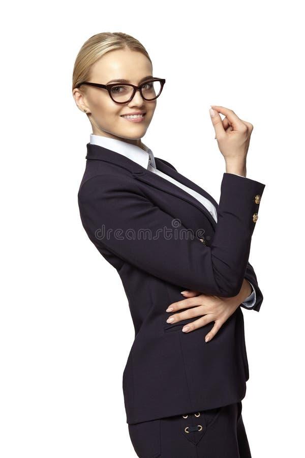 Femme blonde gaie d'affaires avec la main augment?e images stock