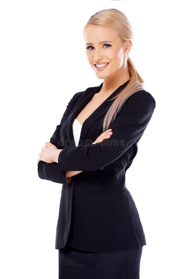 Femme blonde mignonne d'affaires sur le blanc image stock