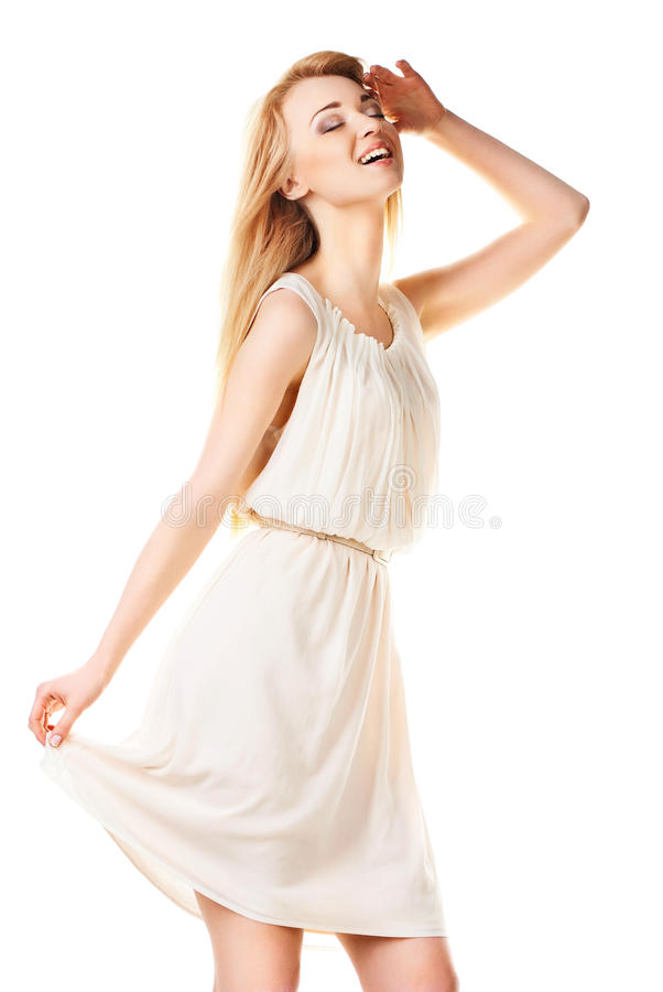 Femme blonde riante avec le long cheveu sur le blanc photographie stock