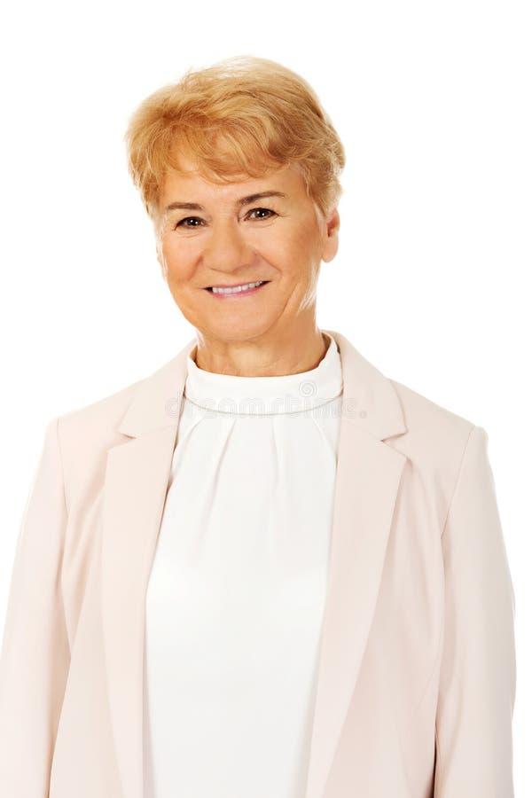 Femme blonde supérieure élégante de sourire photographie stock