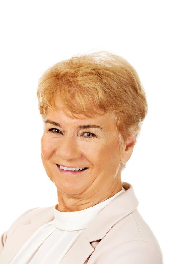 Femme blonde supérieure élégante de sourire image stock