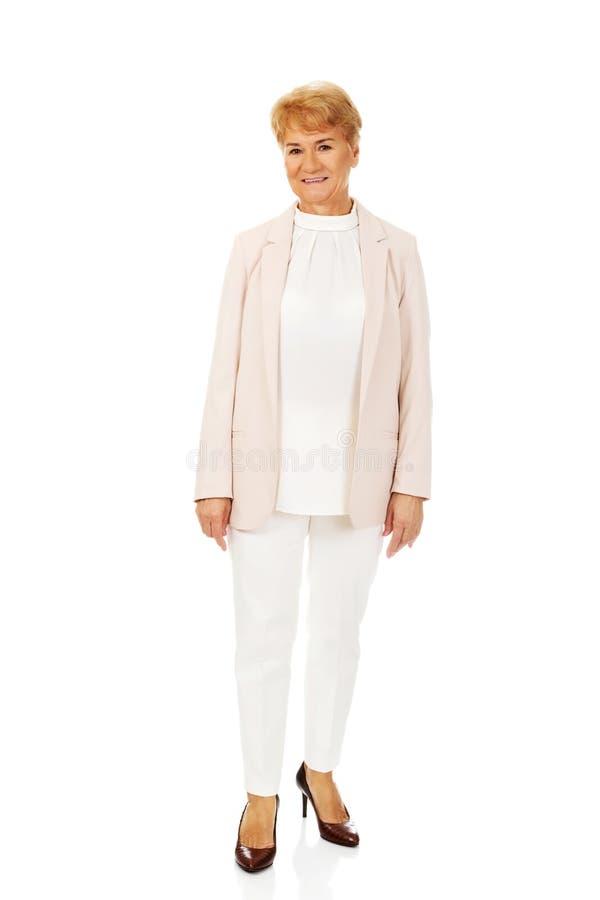 Femme blonde supérieure élégante de sourire photo libre de droits