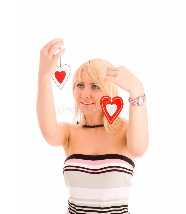 Femme choisissant du coeur deux. Concept photo stock
