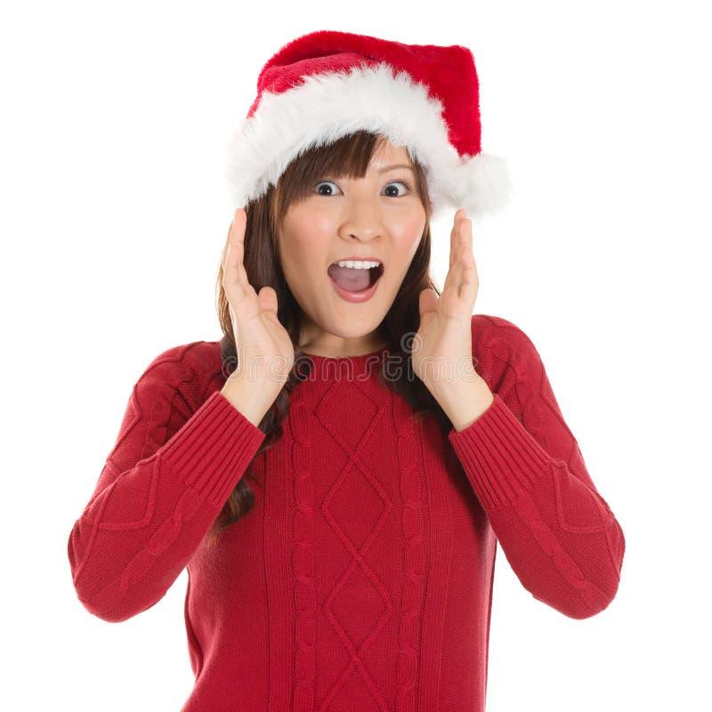 Femme choquée de Santa d'Asiatique images stock